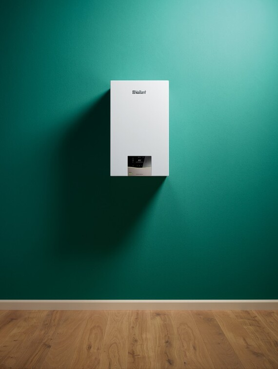 Front view on wall-hung boiler ecoTEC exclusive on a green wall